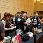 Guests Looking at Auction Items - Tuxedo Cat Ball 2018