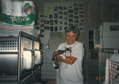 1997 - Mike and Carroway in garage shelter - photos on the walls are of all the cats adopted so far