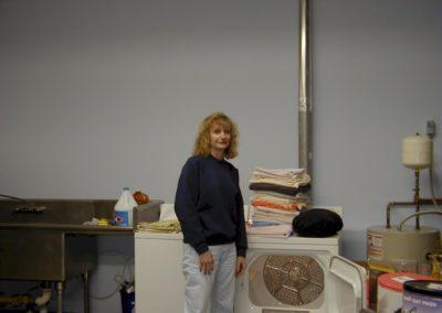 1999 - Volunteers Martha Benton in kitchen laundry of new shelter