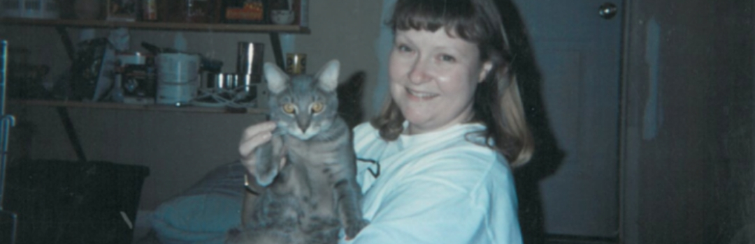 Founder Pam and Cat In Garage That Served As Early Shelter