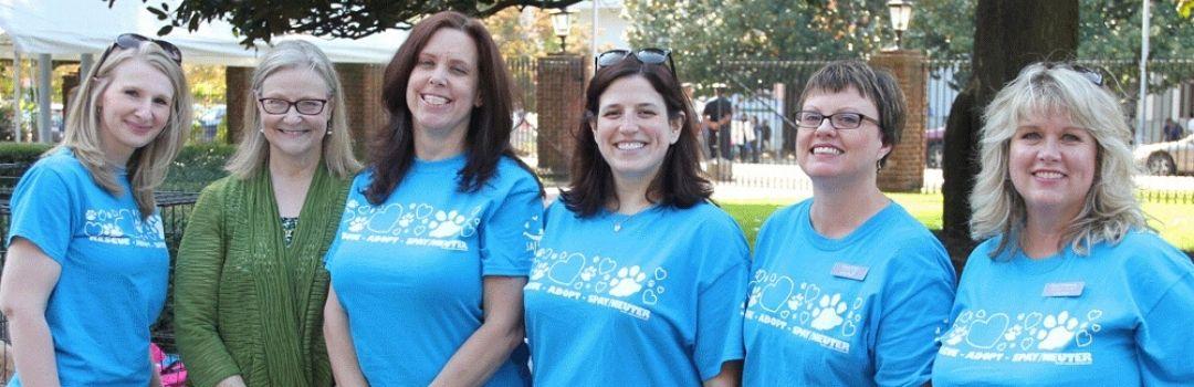 Volunteers Posing With Founder Pam Miller